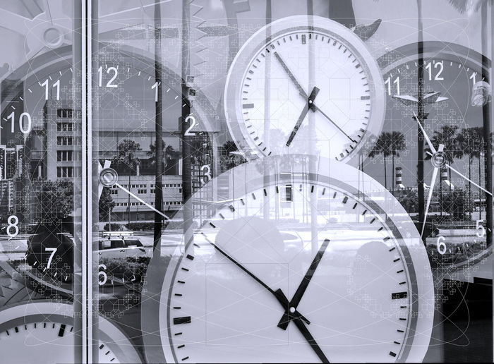 Conceptual image of time and busy lifestyle with large clocks Clock Time Glass - Material Minute Hand Circle Geometric Shape Instrument Of Time Transparent Hour Hand Clock Face Wall Clock Conceptual Image Busy Life Stress Time Pressure Hectic