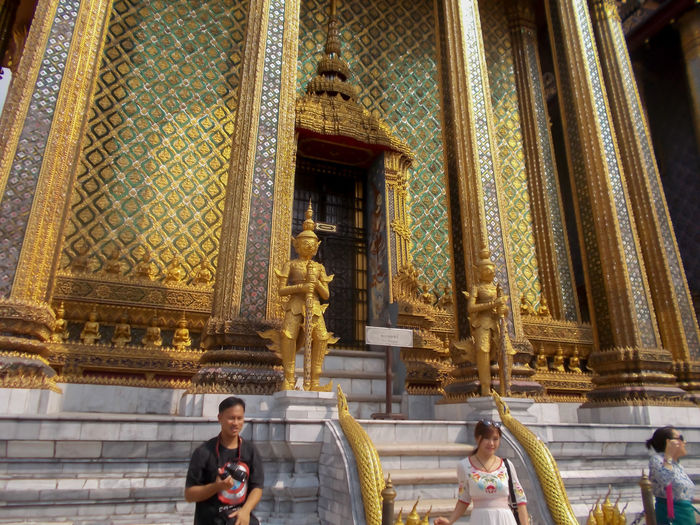 Thailand Bangkok Gold Colored Buddha Travel Wat Phra Kaew Yellow Close-up Golden Color Golden Pagoda Gold Religion Arts Culture And Entertainment Store Old Buddha Statue Outdoors People Day Real People Old Buddha Statue Site Down Buddha Travel Destinations Women men Art And Craft