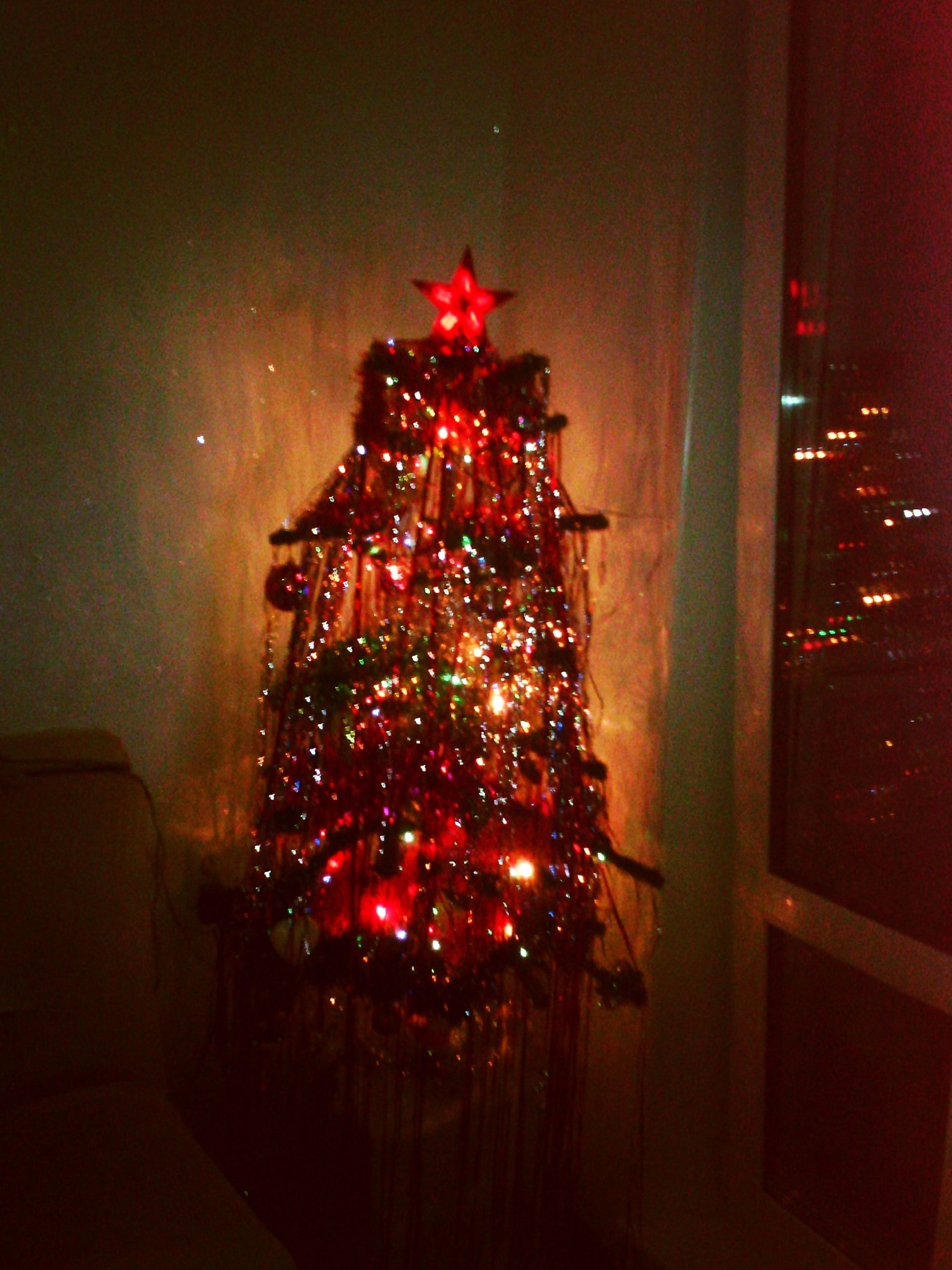 illuminated, indoors, decoration, night, lighting equipment, red, christmas, christmas tree, christmas decoration, architecture, built structure, celebration, hanging, decor, glass - material, christmas lights, home interior, no people, transparent, light - natural phenomenon