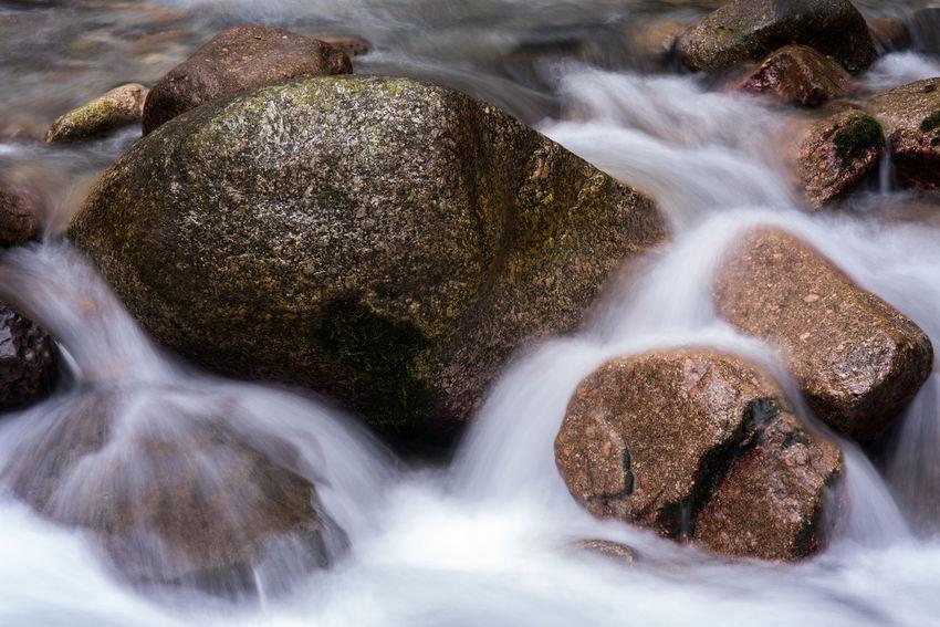 Big and small hard rocks bathing in torrent. Bathing Creek Nature Speeding Textures Washing Beauty In Nature Endurance Mountain Rocks Silk Stones Stream Torrent Water