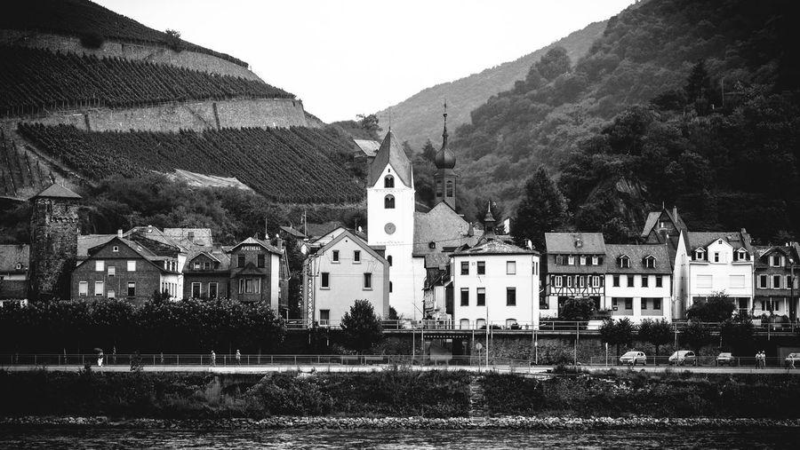 Buildings by river at rudesheim am rhein