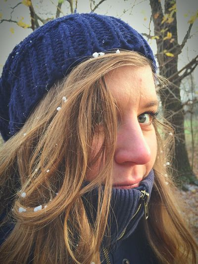Close-Up Portrait Of Young Woman During Winter
