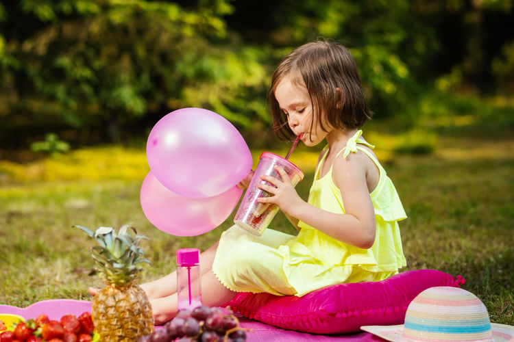Picnic Girl Child Childhood Kid Forest Summer Sitting One Person Holding Females Real People Nature Girls Full Length Casual Clothing Grass Women Plant Leisure Activity Easter Egg Day Food And Drink Innocence Outdoors