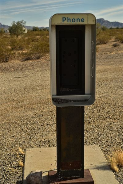 Desert Old Fashioned Old Technology Old Telephone Booth Abandoned Communication Day Empty No People Outdated Tech Outdoors Pay Phone Phone Booth Sky Vending Machine