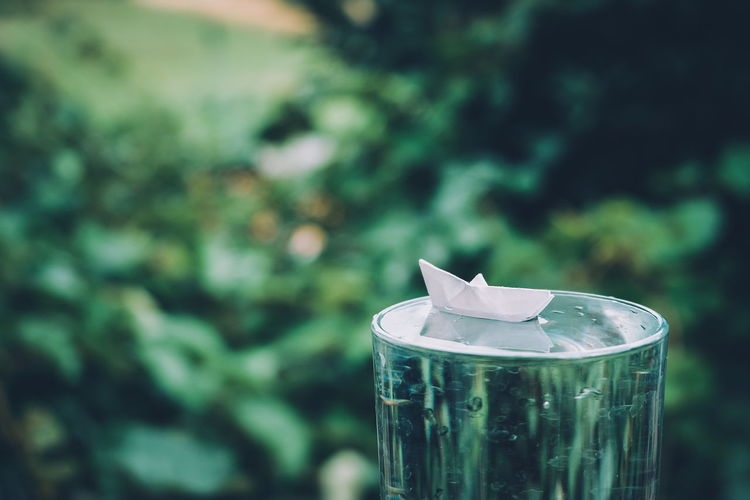 Close-up of paper boat on water