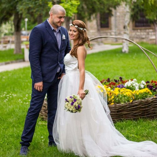 Bride and bridegroom standing on grass