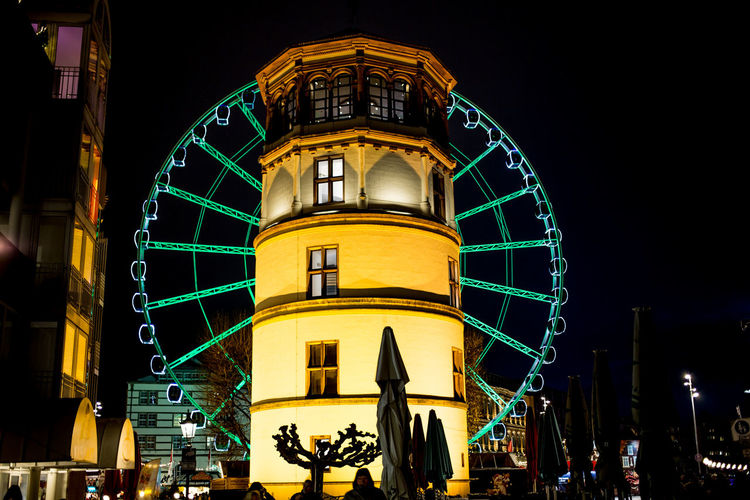 Dusseldorf christmas market Dusseldorf Christmas Market Düsseldorf Architecture Building Exterior Built Structure Illuminated Large Group Of People Low Angle View Night Outdoors People Real People Sky
