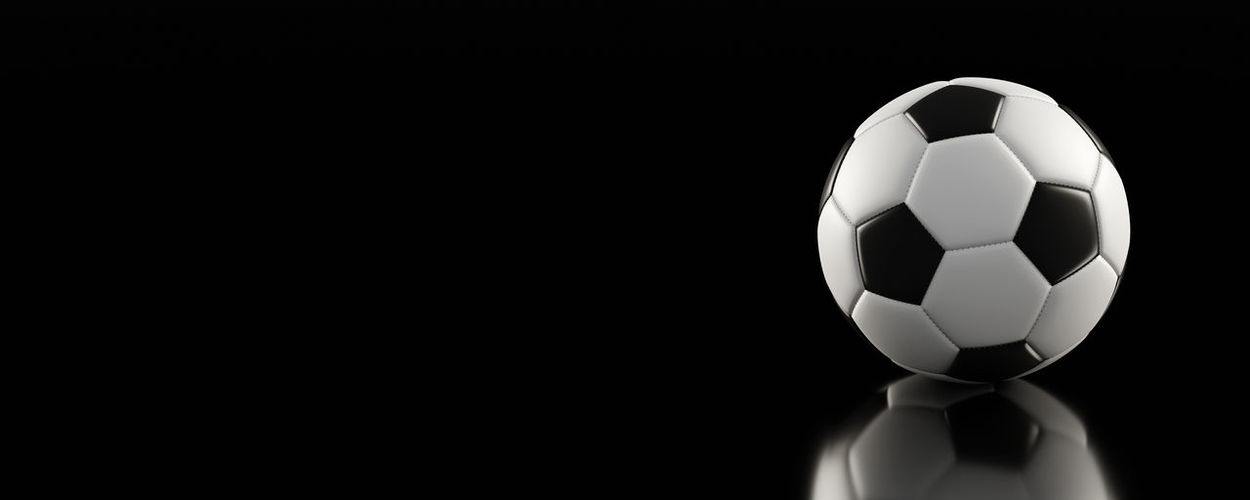 Close-up of soccer ball against black background