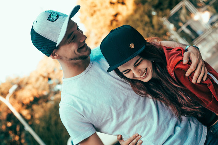 Portrait of young couple kissing outdoors