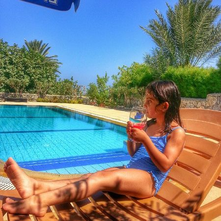 Cyprus Kyrenia Girne Kibris vasilya karsiyaka hayat masala guzel pool trees lemonade cold water weather sky summer orange beautiful gloomy