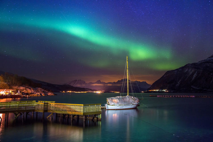 Scenic view of sea with northern lights