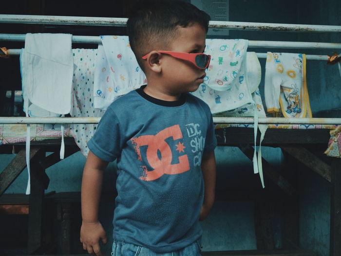 Full length of boy looking at camera