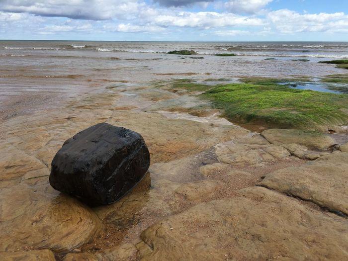 Lump of sea coal in the rocks near Blyth, Northumberland, England EyeEmNewHere Sea Coal Tranquility Coal Outdoors Sea Stone Tranquil Scene Water