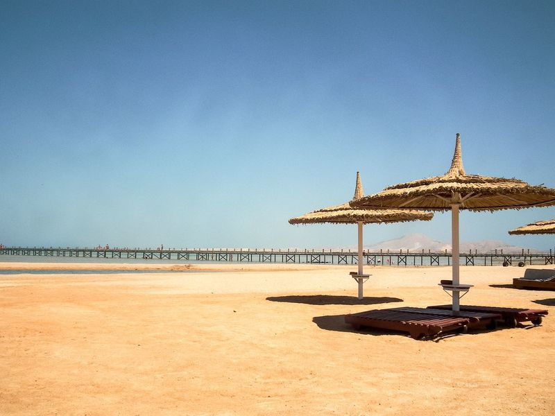 Beach Egypt Sharm El-Sheikh Sea Red Hut Umberella Hot Sunny Warm Architecture Beach Umbrella Beauty In Nature Bridge - Man Made Structure Built Structure Colour Image Horizontal Day No People Outdoors Tranquil Scene Pier Sunlight Shadow Sky