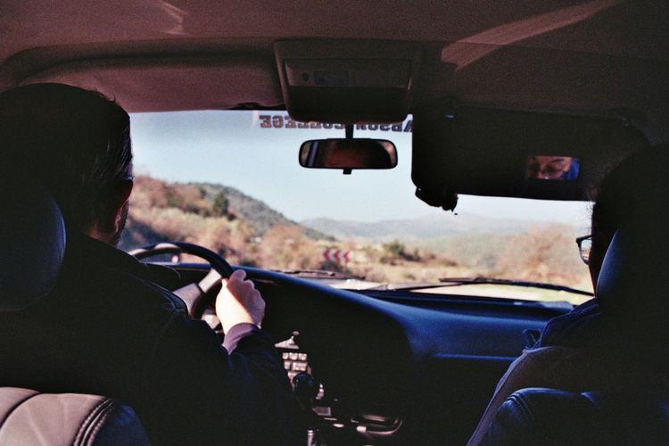 Rear view of man driving car