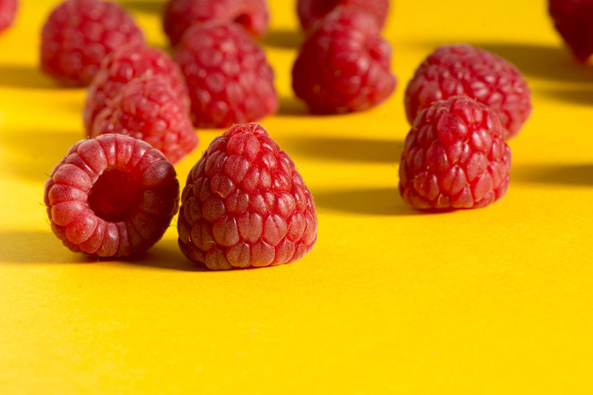 Fresh raspberries on yellow and red background, front view Collage Art Dessert Food And Drink Freshness Freshnesss Healty Food Tasty Dishes Backgrounds Berry Fruit Close-up Colofrul Color Delicious Food And Drink Front View Fruits Nutrition Organic Food Raspberry Rasperries Raw Food Red Color Ripe Fruit Sweet Food Yellow Color