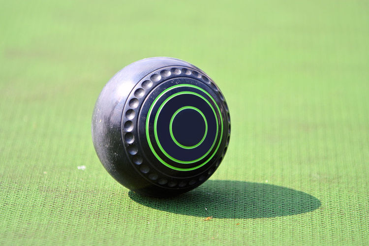 Lawn bowl on the green field Ball Lawn Bowl Bowling Lawn Bowls Green Field Backgrounds Competition Athlete Outdoor Business Sport Healthy EyeEm Selects EyeEm Best Shots EyeEmBestPics Eyeemphotography Close-up Close-up Green Color Full Frame Textured