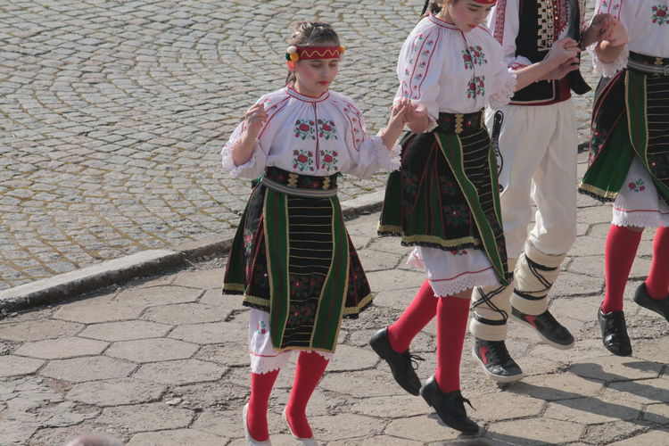 Traditional Bulgarian festival for exorcism Casual Clothing Childhood Colors Of Carnival Enjoyment Friendship Front View Full Length Fun Holding Leisure Activity Lifestyles Looking At Camera Occupation Perspective Portrait Real People Standing Three Quarter Length Togetherness Women Young Adult