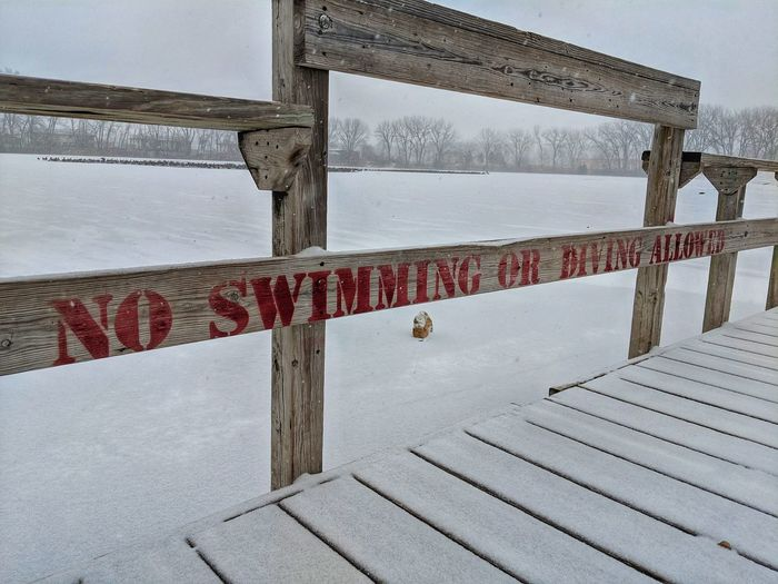 Winter Snow Ice Frozen Lake No Swimming Sign No Diving Cold Lake Sky Close-up Bridge - Man Made Structure Waterfront