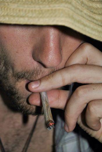 Close-up of man smoking marijuana