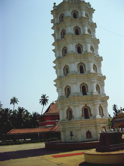 Religion Architecture Place Of Worship Clear Sky Travel Destinations City Building Exterior Façade History No People Spirituality Palm Tree Tree Outdoors Sky Day Clock Ancient Architecture In Goa.(india) In Goa Goa Miles Away