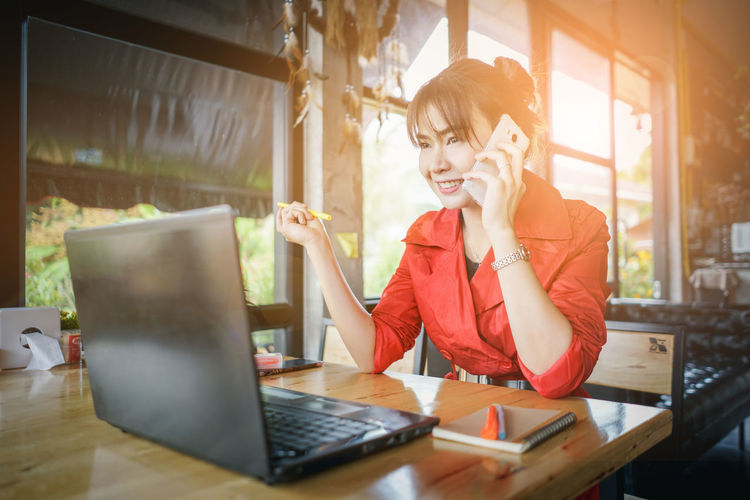 Smiling Woman Working On Table At Home