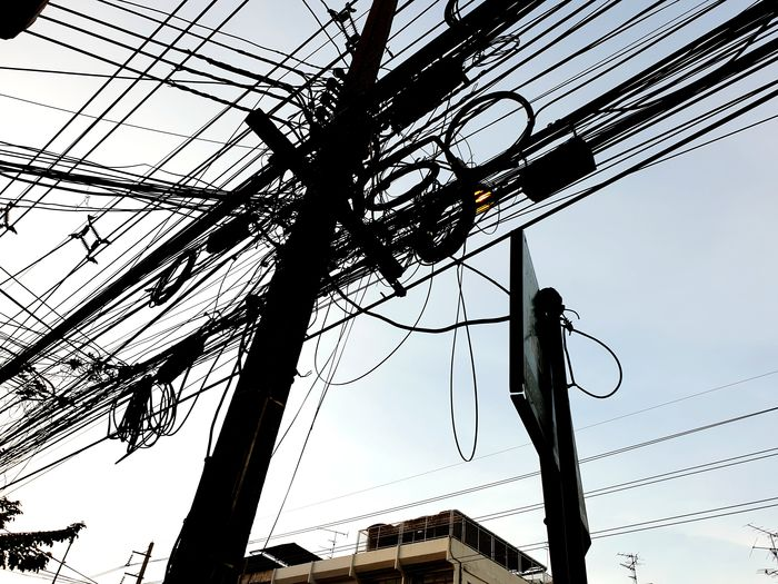 Tangled wires in thailand Tangled Wires Blue Sky Thailand Telephone Line Electricity  Cable Technology Power Line  Electricity Pylon Sky Electric Pole Power Cable Power Supply Electric Meter Outlet Electric Plug Electrical Grid Girder Fuse Box Meter - Instrument Of Measurement Electrical Component High Voltage Sign