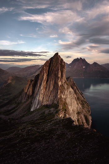 Segla mountain in Senja, Norway Beauty In Nature Cloud - Sky Eroded Formation Idyllic Mountain Mountain Peak Mountain Range Nature No People Non-urban Scene Outdoors Remote Rock Rock - Object Rock Formation Scenics - Nature Segla Sky Solid Sunset Tranquil Scene Tranquility Volcanic Crater Water