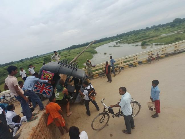 Ran across a blocked bridge in India. The only solution was to recruit some bystanders to lift our rickshaw over the blockade(s)Only Finding New Frontiers Outdoors Bridge India Varanasi, India Ganges, Indian Lifestyle And Culture, Bathing In The Ganges, Varanasi Rickshaw Adventure