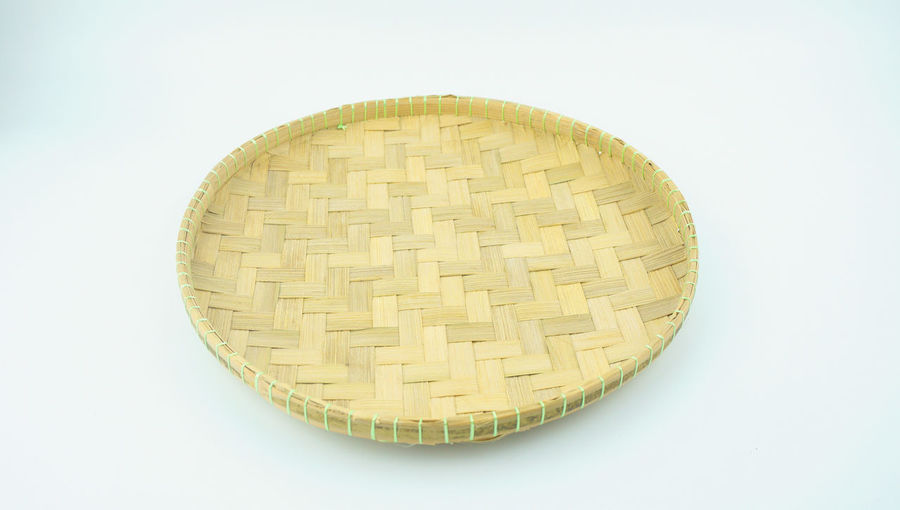 Weaving craft tray made of pine on white background. Basket Circle Close-up Copy Space Day Handmade Indoors  Isolated No People Pattern Studio Shot Traditional Tray Weaving Weaving Craft White Background