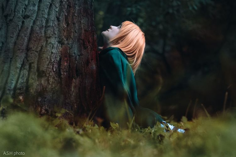 Side view of woman in forest