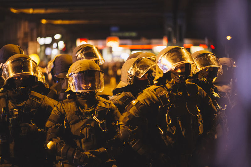 G20 Summit Protest Armed Forces Army Soldier Clothing Government Group Of People Headwear Helmet Helmets Illuminated Military Military Uniform Night Police At Work Police Force Police Uniform Protection Protective Workwear Real People Safety Security Standing Togetherness Uniform