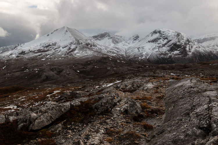 Scenic view of snowcapped ridges of Beinn Eighe against sky. - Scotland, 2016 Remote Nature Hiking Sky Landscape Exploring Scenery Winter Travel Snow Day Outdoors Rock Scotland Tranquility Escape Mountain Wilderness Environment Range Mountain Peak Dramatic Landscape Scottish Highlands Beauty In Nature No People Remote Location Travel Destinations Tranquil Scene Mountain Range Rock - Object Cloud - Sky Cold Temperature Snowcapped Mountain Scenics - Nature Beinn Eighe The Great Outdoors - 2019 EyeEm Awards