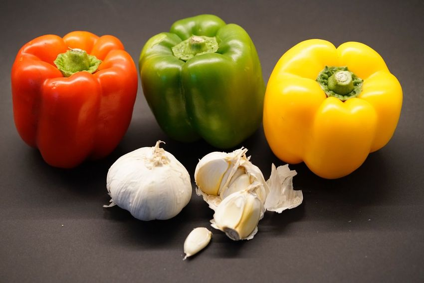 Still Life Food And Drink Food Vegetable Healthy Eating Freshness Garlic Bell Pepper Raw Food Close-up No People Red Bell Pepper Table Studio Shot Indoors  Black Background Day