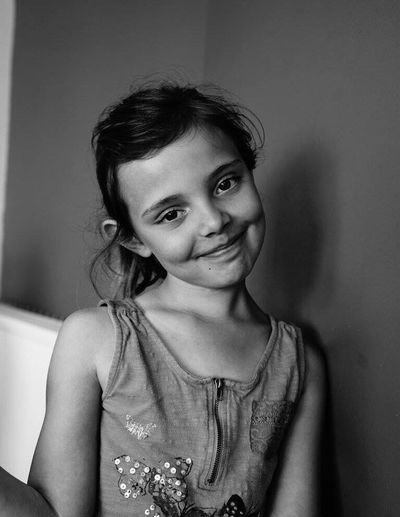 Childhood Child Elementary Age Smile One Person One Girl Only Blackandwhite Black And White Smiling Portrait Real People Innocence Headshot People Home Interior Looking At Camera Sony SONY A7ii Happy Happiness