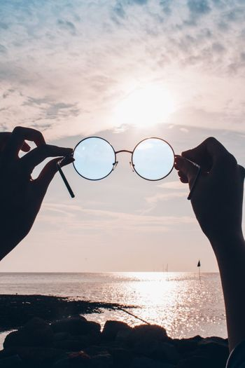 👓👓 Water Sky Sea Real People Human Hand One Person Beach Land Lifestyles Holding Hand Horizon Over Water Outdoors Beauty In Nature Human Body Part Nature Glasses Leisure Activity Body Part Sunset