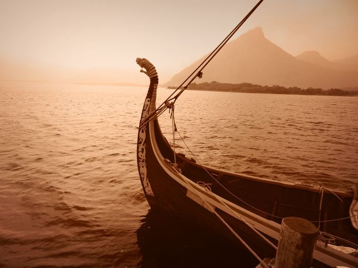 Dragon Norway Vikings  Beauty In Nature Day Dragonship Mode Of Transportation Moored Nature Nautical Vessel No People Non-urban Scene Outdoors Rope Sailboat Scenics - Nature Sea Sky Sunset Tranquil Scene Tranquility Transportation Travel Viking Ship Water