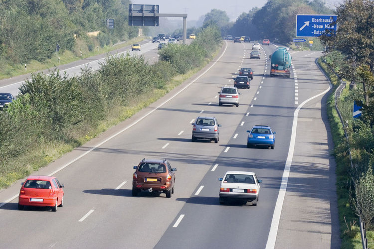 traffic on the highway - autobahn in oberhausen, germany A42 Air Pollution Autobahn Automobile Car Commuter Freeway Germany High Angle View Highway Highways&Freeways Land Vehicle Mode Of Transport No People NRW Oberhausen On The Move Pollution Road Ruhrgebiet Rush Hour Scenery Traffic Traffic Transportation