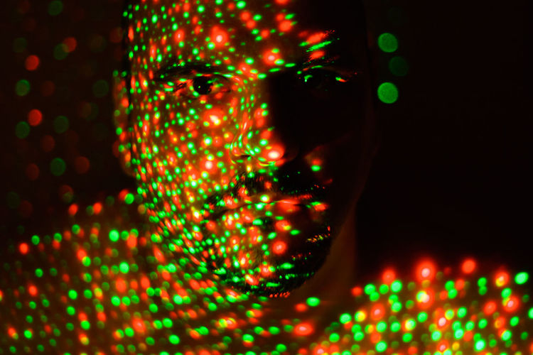Christmas in my face Christmas Christmas Lights Abstract Black Background Christmas In My Face Close-up Cyberspace Data Defocused Futuristic Glowing Illuminated Mother Board Multi Colored Neon Night One Man Only One Person Only Men Pattern People Red Science Technology Be. Ready.