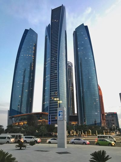 Panoramic view of modern buildings against sky in city