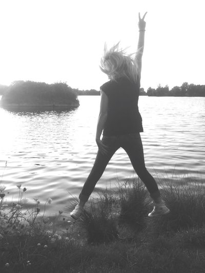 One Person EyeEmNewHere Jump Jumping Lake Jumpshot Evening Sky Real People Water Trees Nature Nature Photography People Photography Jumper Women Women Who Inspire You Women Around The World Beauty In Nature Best Friend ❤ Evening Shot Reflection Sky Evening Light Sunset Silhouettes Fearless And Faithful Welcome To Black Resist BYOPaper!