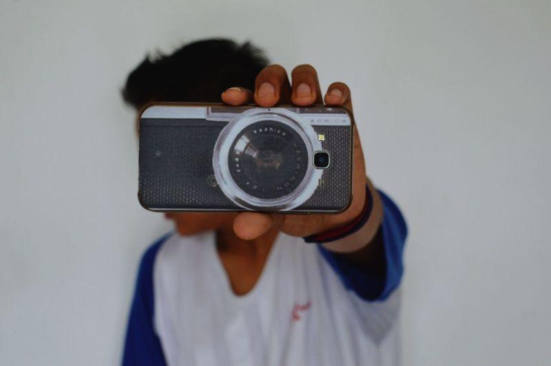 Teenage boy looking away from camera