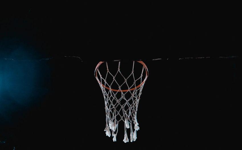 Basketball - Ball Basketball - Sport Basketball Hoop Black Background Competition Copy Space Dark Indoors  Motion Net - Sports Equipment Night No People Scoring Sport Studio Shot Success Taking A Shot - Sport