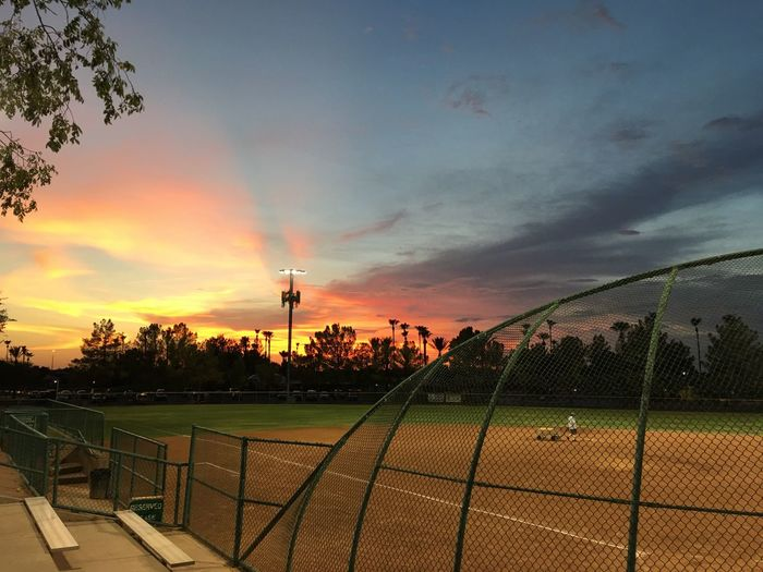 Softball playoffs AND a Beautiful sunset! 🌅 Sunset Cloud - Sky Sky Sport Outdoors Playing Field Beauty In Nature Nature Evening Light Softball Mens League Backstop Bases