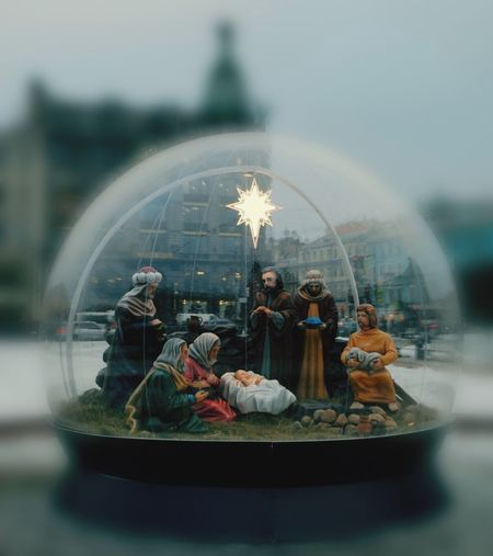 Group of people in glass container