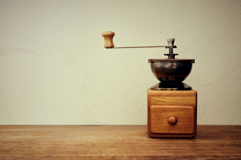 Coffee grinder on table at home