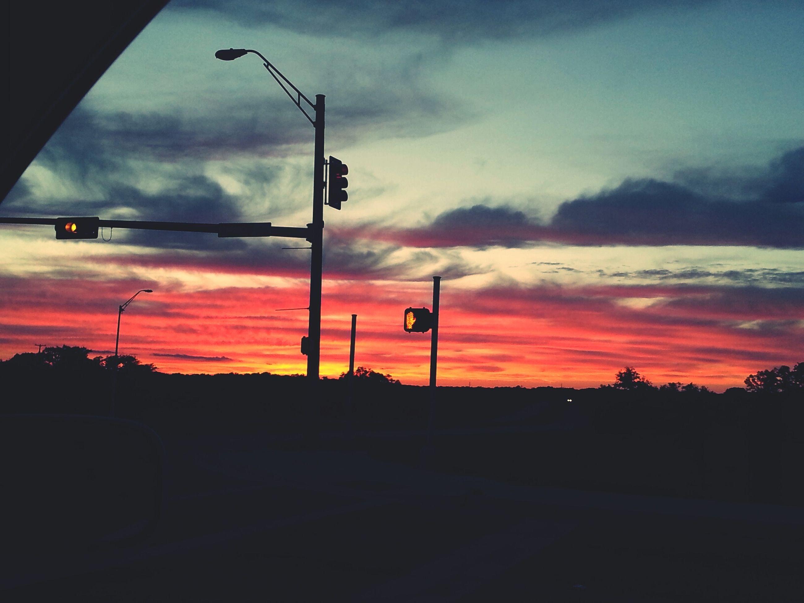 sunset, sky, silhouette, transportation, orange color, cloud - sky, street light, road, car, cloud, land vehicle, dramatic sky, cloudy, dark, mode of transport, scenics, dusk, beauty in nature, street, nature