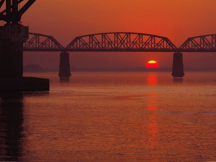 City Cityscape Urban Skyline Water Sea Horizon Low Tide Industry Sunset Complexity Railway Bridge Railroad Bridge