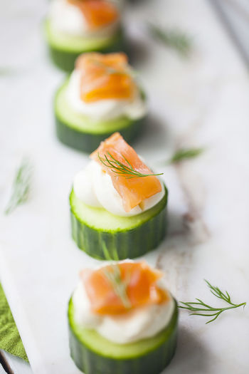 Healthy Eating Food And Drink Wellbeing Food Freshness SLICE Close-up Still Life Seafood Salmon - Seafood Garnish Table Cucumber Salmon Dill Appetizer Hors D'oeuvres Entertaining Cream Cheese Green Nutritious White Marble Healthy Snack Snack Lox
