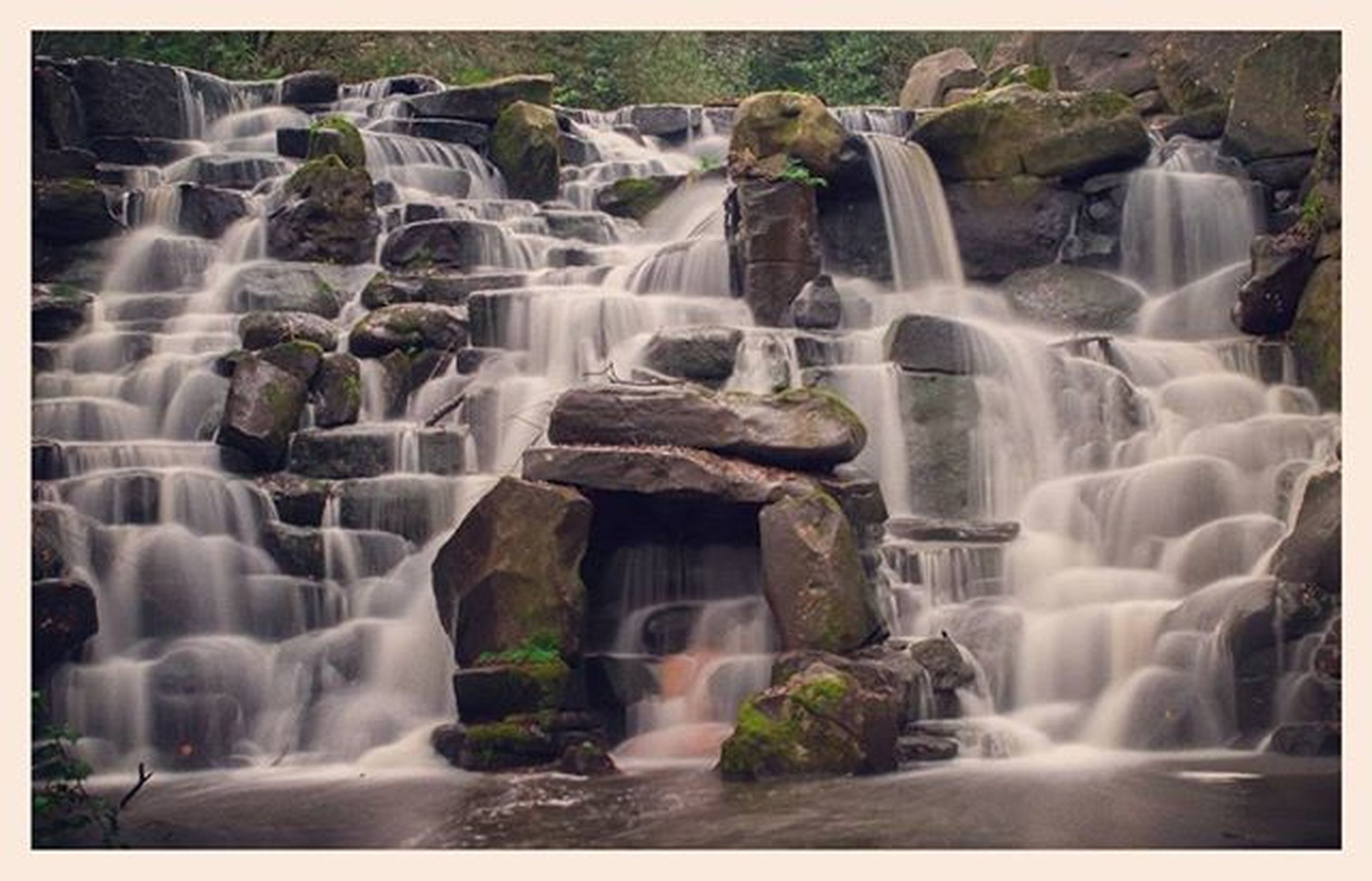 waterfall, motion, flowing water, long exposure, water, flowing, splashing, rock - object, fountain, nature, blurred motion, beauty in nature, day, scenics, outdoors, power in nature, spraying, no people, low angle view, environment